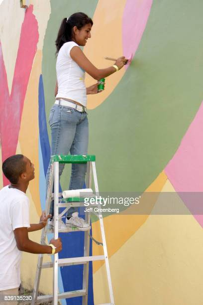 A man and woman painting a mural at Hands on Miami Day
