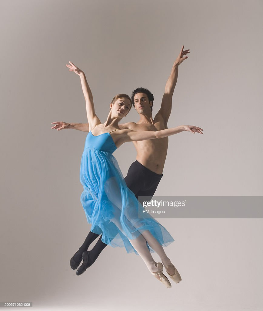 Man and woman performing ballet pose in mid-air : Stock Photo