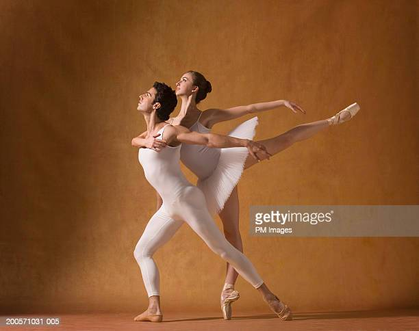 Man and woman performing ballet, side view