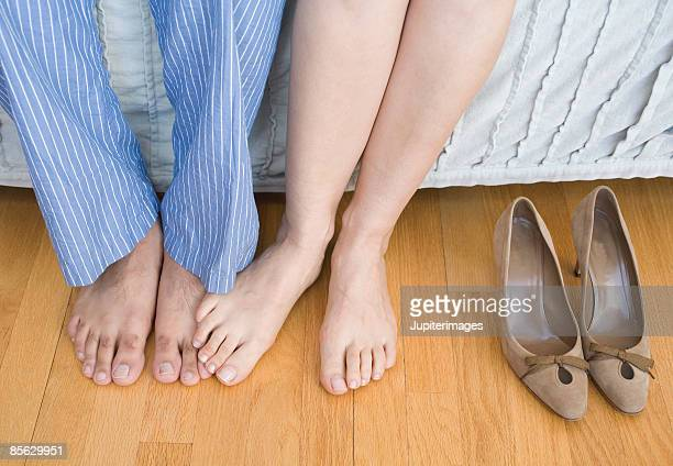 Man and woman playing footsie