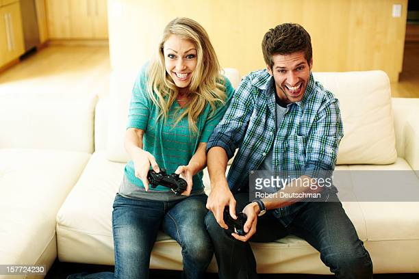 Man and woman playing video games.