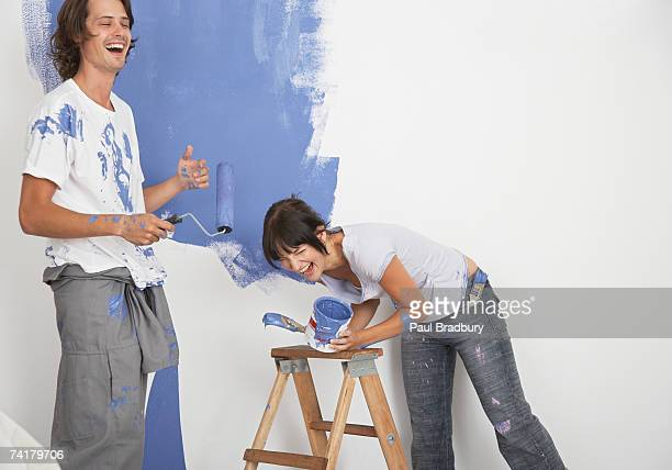 Man and woman playing with paint