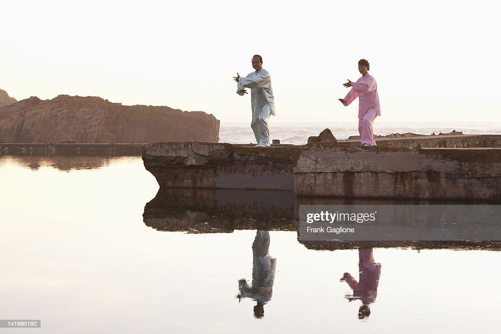 Man and woman practicing Tai Chi. : Stock Photo