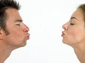 Man and woman puckering lips