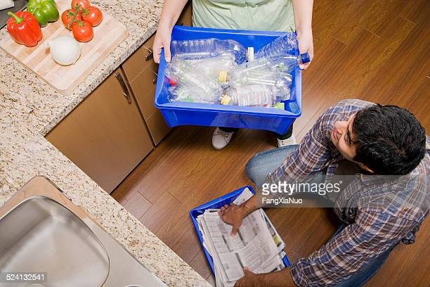 Man and Woman Recycling Plastic and Paper