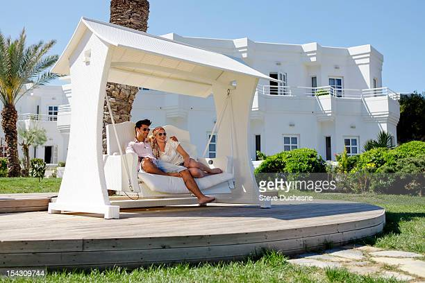 Man and woman relaxing in garden