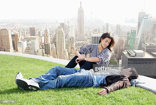 man and woman relaxing with new york skyline