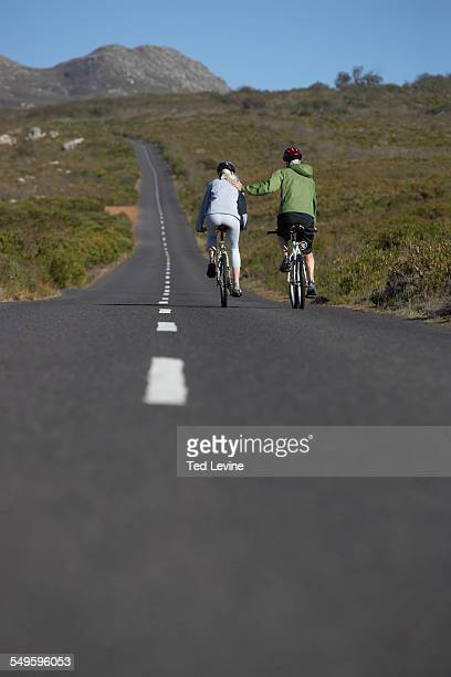 Man and Woman Riding Mountainbike on Road