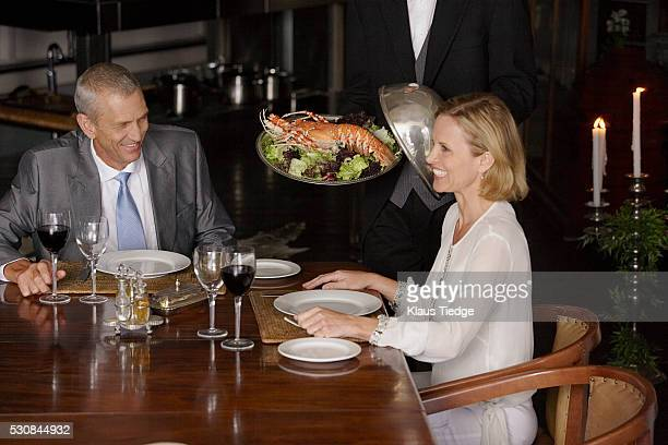 Man and woman sitting at dinner table