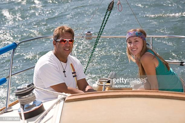 Man and Woman Smiling while Sailing on Sail Boat