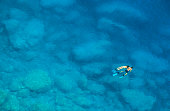 Couple snorkeling in wonderful turquoise water - Mediterranean Sea, Greece  See also [url=http://www.istockphoto.com/file_closeup_edit.php?id=5333864&refnum=aprott][img]http://www.istockphoto.com/file