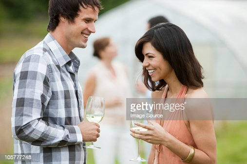 Man and woman socializing outdoors