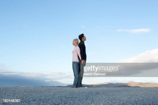 Man and woman standing back-to-back