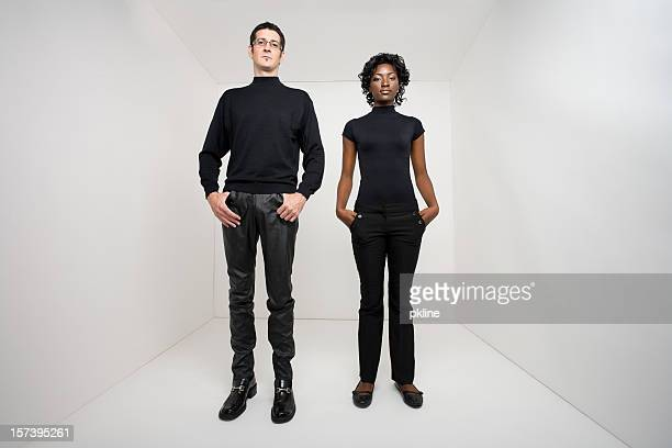 Man and woman standing in a white room