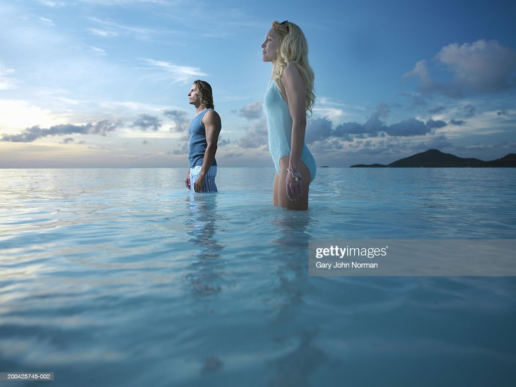 Man and woman standing in sea : Stock Photo