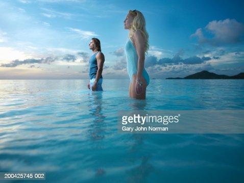 Man and woman standing in sea : Bildbanksbilder