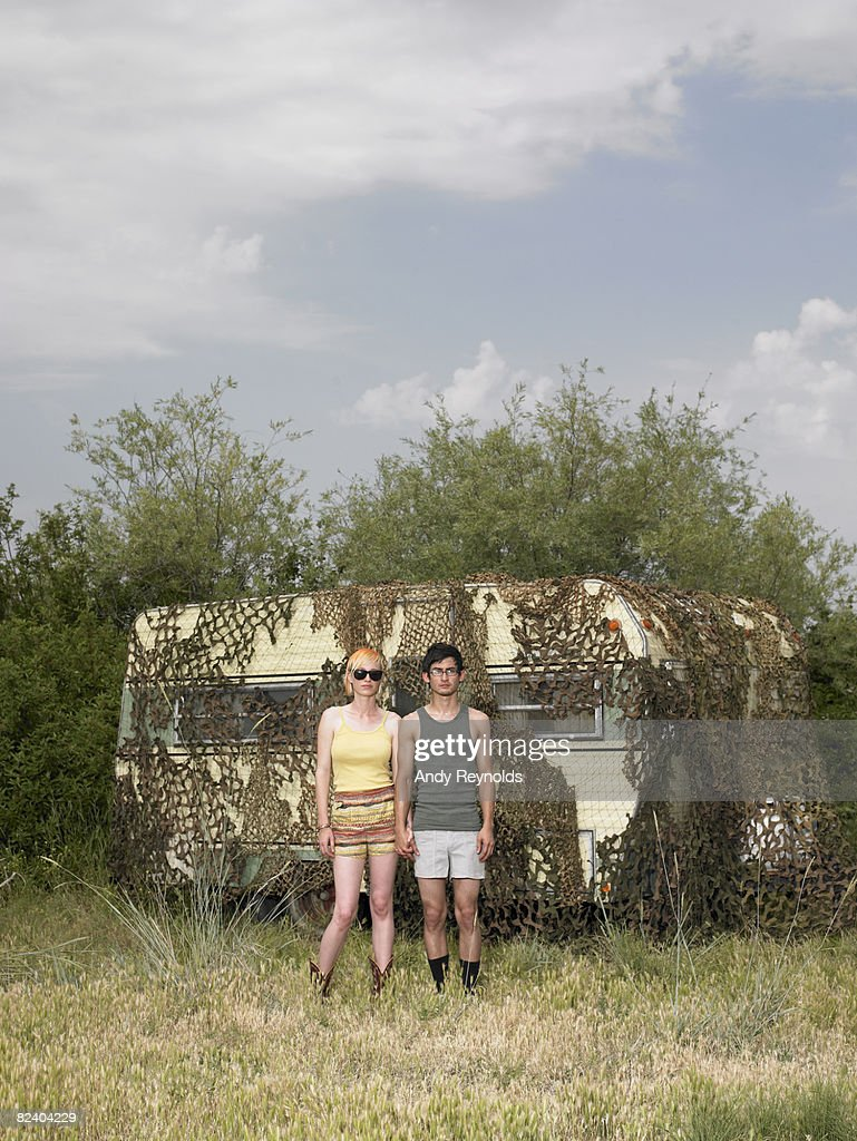 man and woman standing next to trailer : Stock Photo