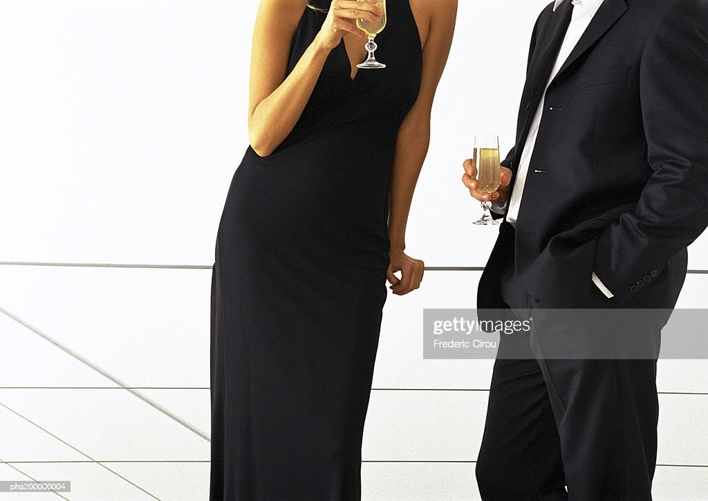 Man and woman standing together drinking wine, mid-section. : Stock Photo