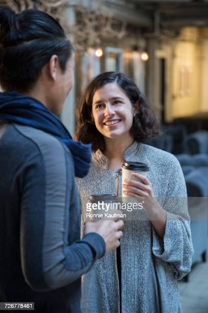 Man and woman talking and drinking coffee
