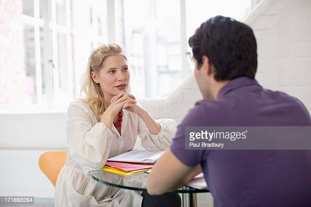 Man and woman talking at table