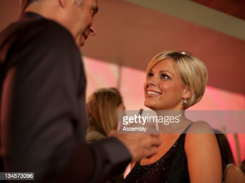 Man and woman talking in a cocktail lounge. : Stock Photo