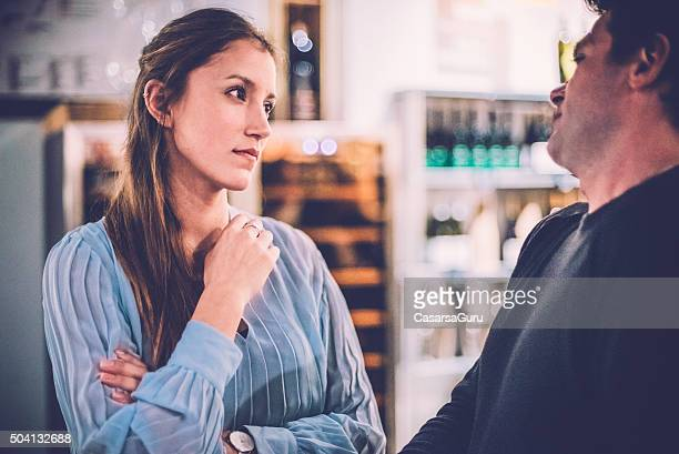 Man And Woman Talking in a Wine Bar