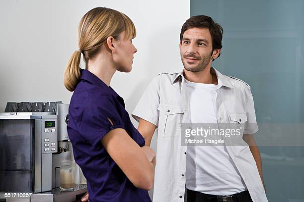 Man and Woman Talking in Break Room