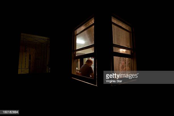 Man and woman talking in house at night