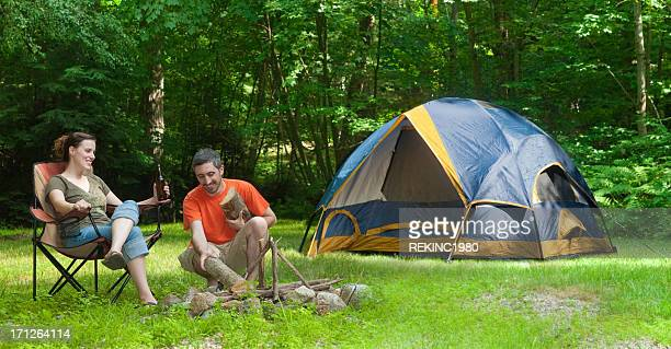 Man and Woman Tent Camping Making a Campfire