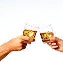 Man and woman toasting drinks, close-up