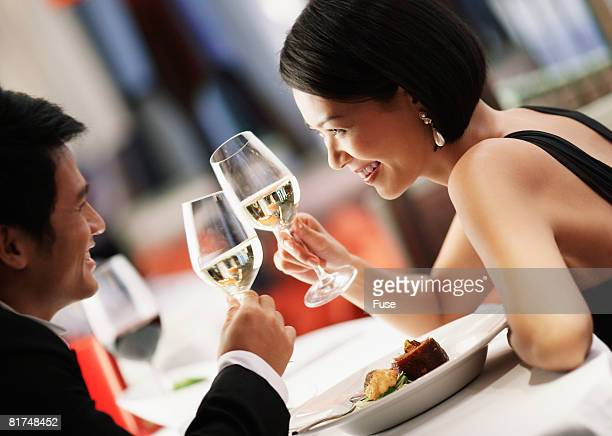 Man and Woman Toasting Glasses