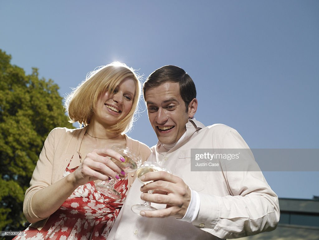 Man and Woman toasting with champagne in garden : Stock Photo