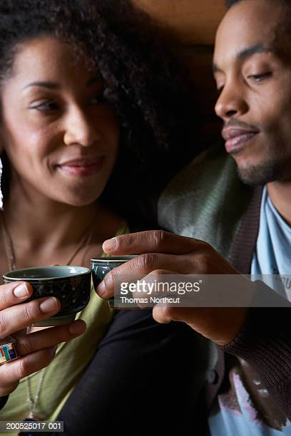 Man and woman toasting with sake