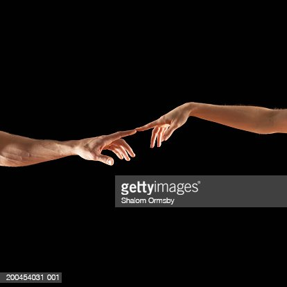 Man and woman touching fingertips : Stock Photo