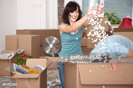 Man and woman unpacking cardboard boxes