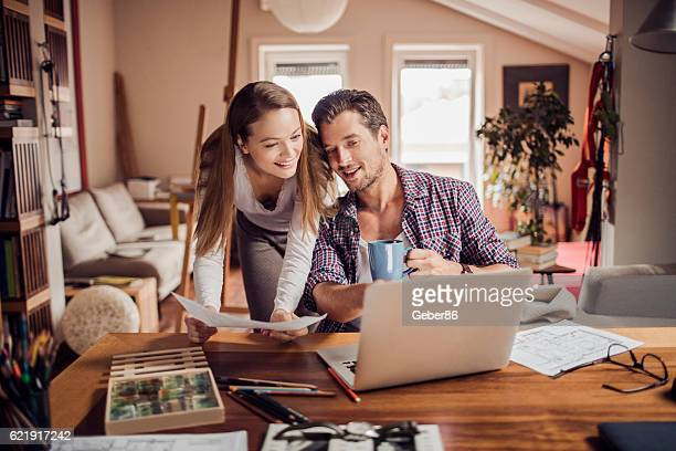 Man and woman using a laptop