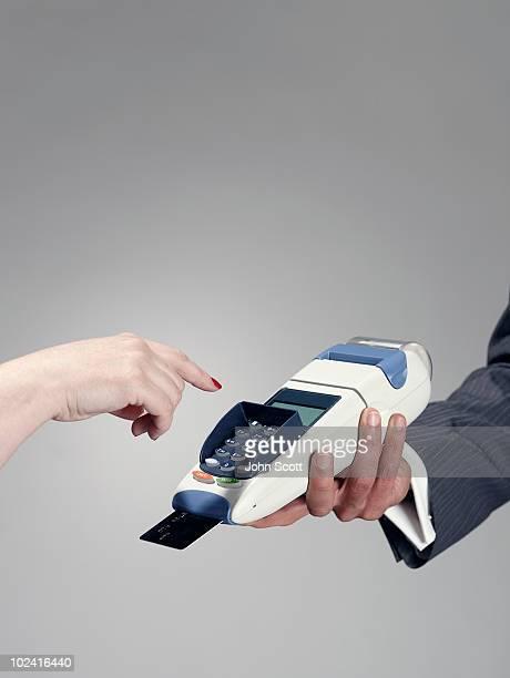 Man and woman using credit card terminal