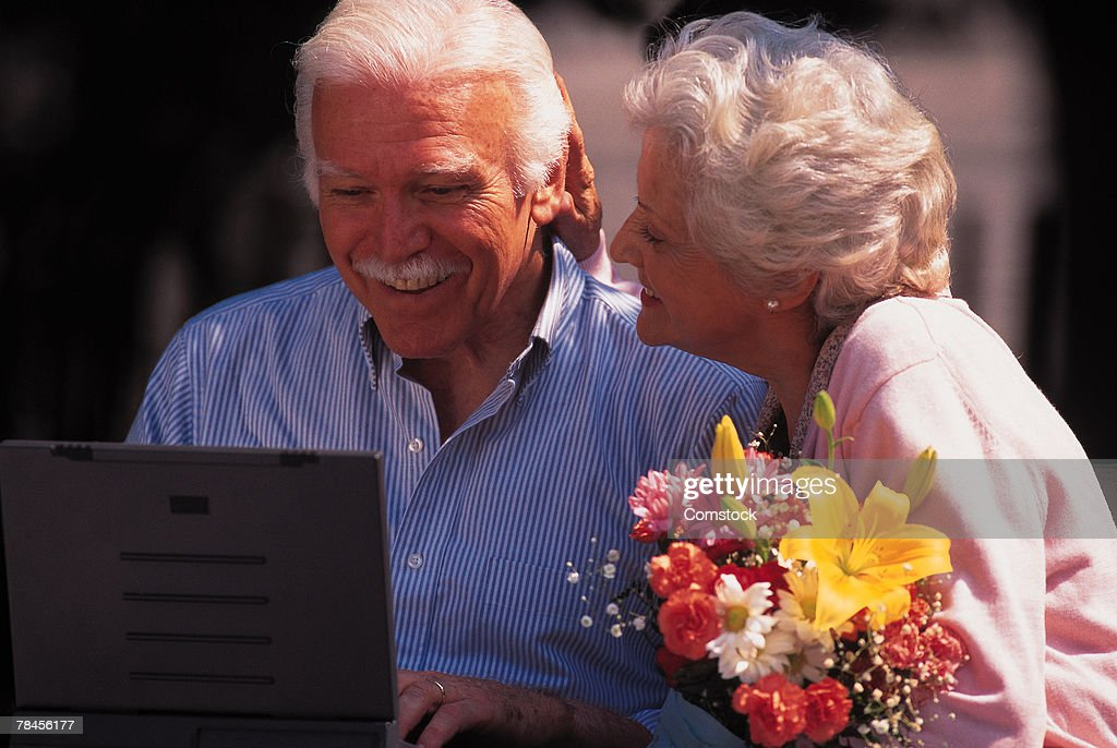 Man and woman using laptop computer : Stock Photo