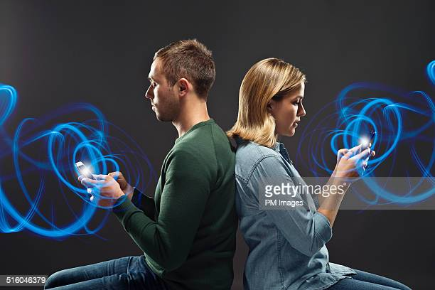 Man and Woman Using Smart Phones