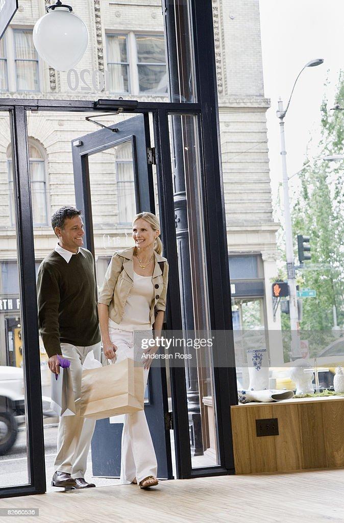 Man and woman walking in : Foto de stock