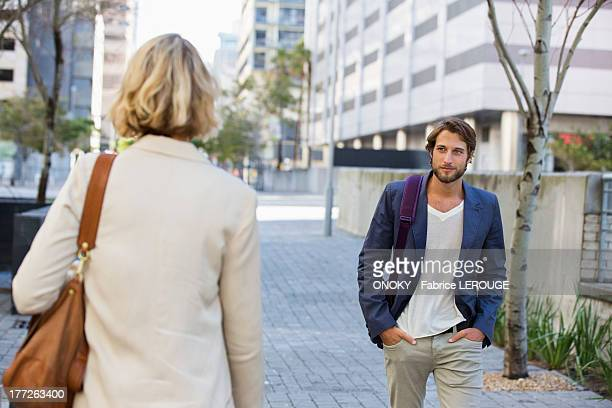 Man and woman walking on a street