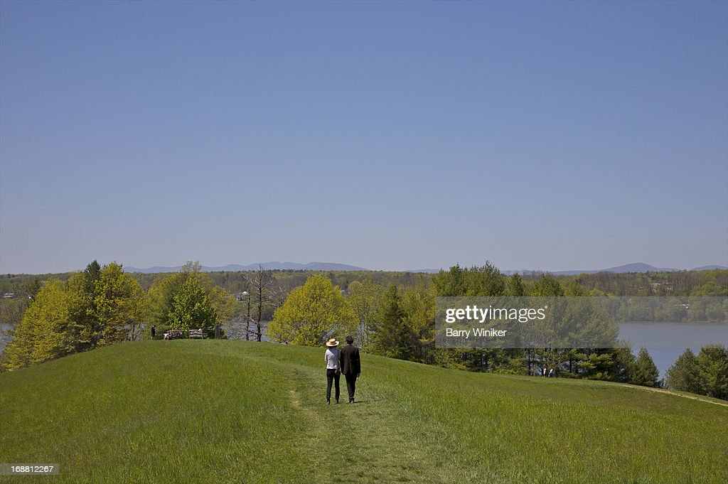 Man and woman walking on hilltop