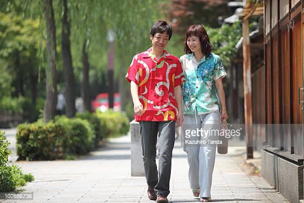 man and woman walking on Kyoto street