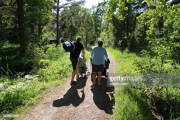 Man and woman walking with pram on vacation