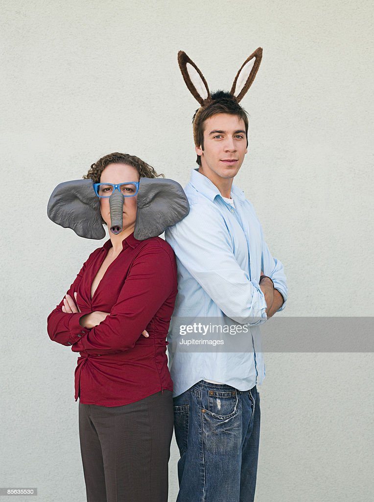 Man and woman wearing donkey and elephant ears : Stock Photo