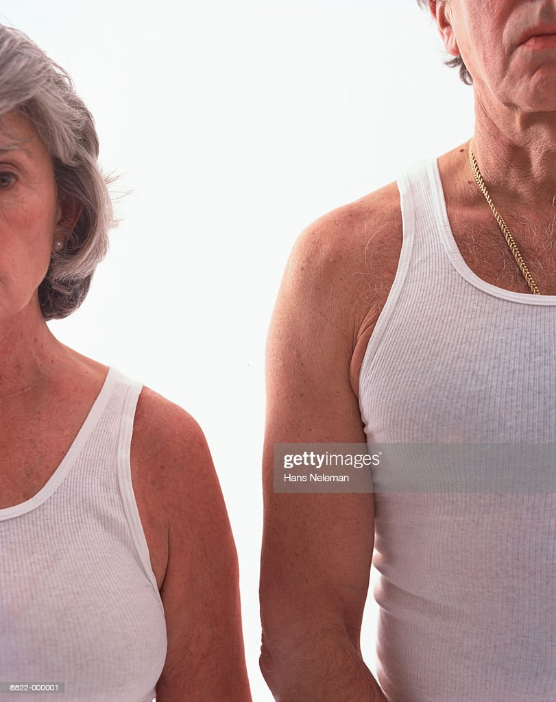 Man and Woman Wearing Vests : Stock Photo