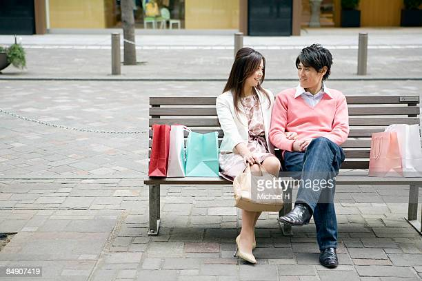Man and woman who takes a rest on bench