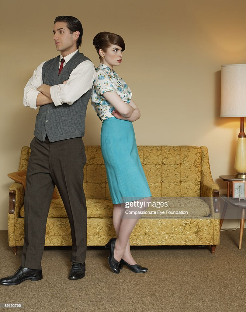 man and woman with crossed arms standing together : Stock Photo
