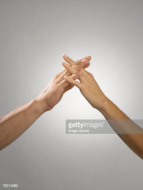 Man and woman with fingers entwined