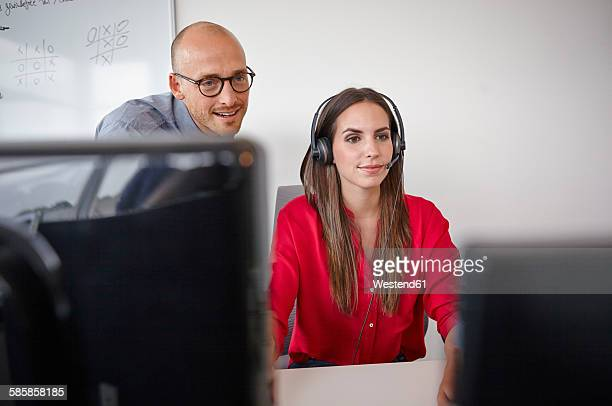 Man and woman with headset in office